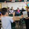 Students showcase their work through technology.