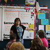 A teacher gives a presentation.