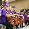 Close-up of Suzuki Strings students playing.