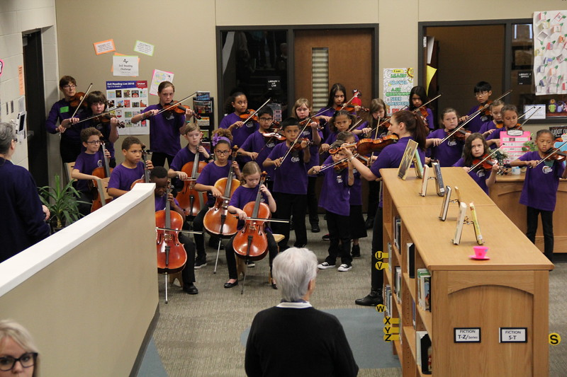 Suzuki Strings students play for the guests.
