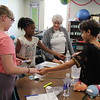 Students and guests do science experiments.