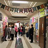 Visitors stand in a decorated hallway.