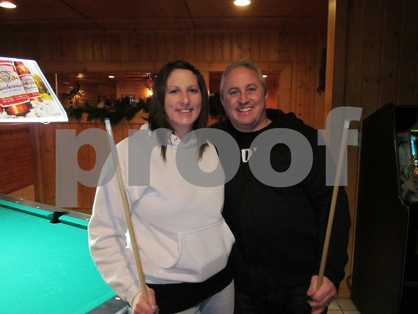 Husband and wife Andrea and Chris Harrison playing pool league at Community Pizza.