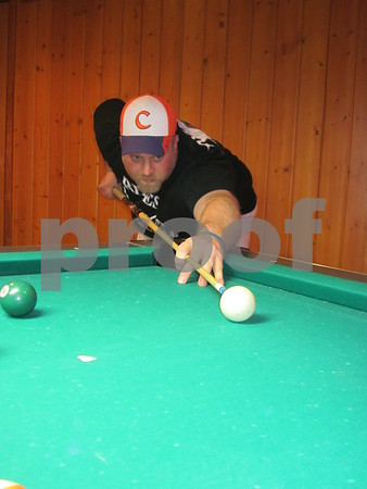 Tony Minard member of The Third Wheel Thursday night pool league team lines up a shot.