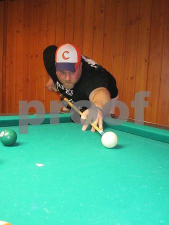 Tony Minard member of The Third Wheel Thursday night pool league team lines up a shot.