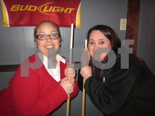 Heather Rooks and Heather Lenning pose with their pool cues during Thursday night pool league at 4th Street Depot.