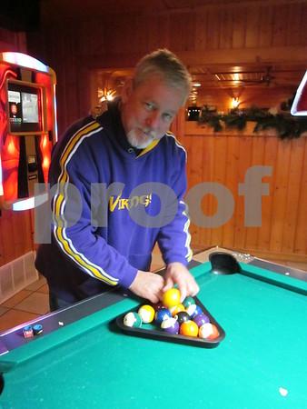 Ken Miller racks up the balls for his game.