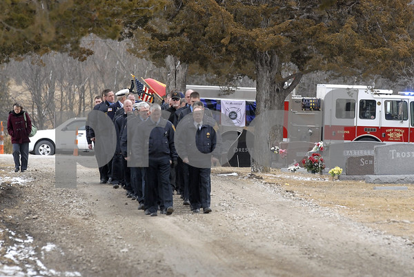 -Messenger photo by Hans Madsen<br /> <br /> Members of the Fort Dodge Fire Department carry the remains of their fellow firefighter Tom Peart to the graveside service at Corpus Christi Cemetery Wednesday from Engine 4 which was parked on 15th Street North.