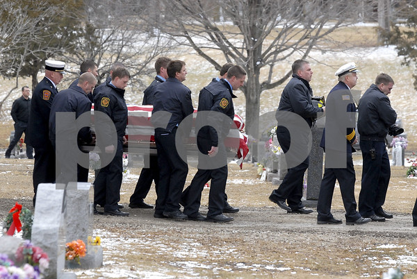 -Messenger photo by Hans Madsen<br /> <br /> Fort Dodge firefighters carry the casket of fellow firefighter Tom Peart into Corpus Christi Cemetery Wednesday afternoon. Due to weight and height restrictions, they were not able to bring the fire truck being used as a hearse into the cemetery.