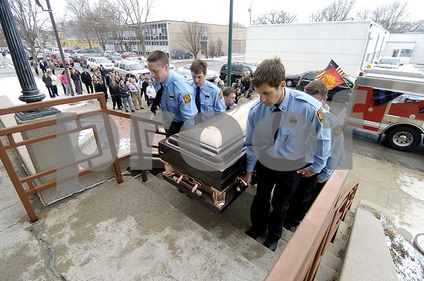 -Messenger photo by Hans Madsen<br /> <br /> Members of the Fort Dodge Fire Department carry the remains of fellow firefighter Tom Peart into Sacred Heart Catholic Church Wednesday morning.