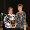 School representatives hold award for volunteer hours.