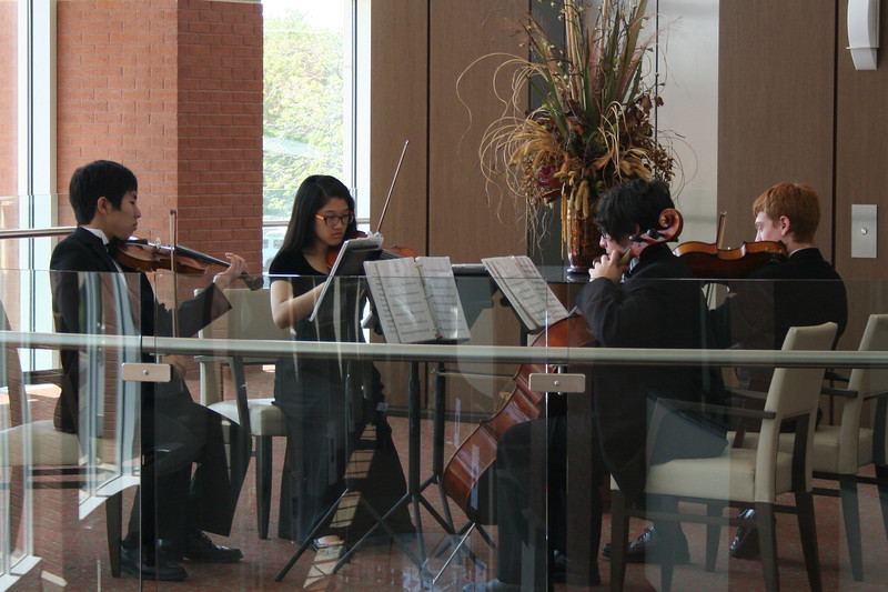 L.D. Bell orchestra students playing music.