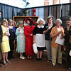 Teachers posing with theatre students dressed as characters from Clue.