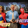 Trinity improv members dressed as superheroes with school district sponsor.
