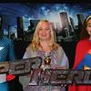 Trinity improv members dressed as superheroes with honored volunteers.