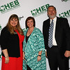 Gold Apple Pin recipient Crystal Sadler with school board president Julie Cole and Superintendent Steve Chapman.
