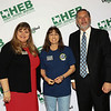 Gold Apple Pin recipient Dalesa Reeves with school board president Julie Cole and Superintendent Steve Chapman.