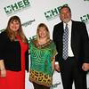 Gold Apple Pin recipient Rachael Metcalf with school board president Julie Cole and Superintendent Steve Chapman.