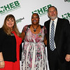 Gold Apple Pin recipient Lashelle Knox with school board president Julie Cole and Superintendent Steve Chapman.