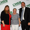 Gold Apple Pin recipient Joyce Rider with school board president Julie Cole and Superintendent Steve Chapman.