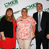 Gold Apple Pin recipient Shelley Helsel-Kuhns with school board president Julie Cole and Superintendent Steve Chapman.