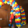 Superintendent walks through a balloon arch.
