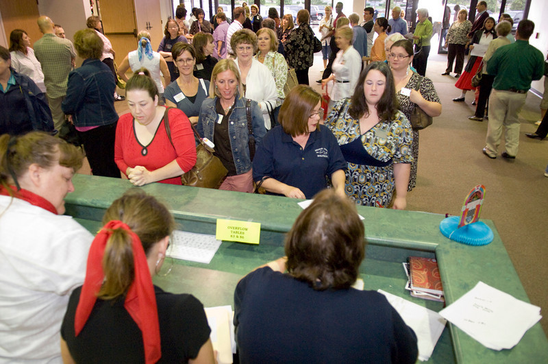 Volunteers check in to be seated.