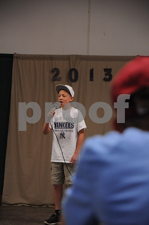 -Messenger photo by Joe Sutter<br /> <br /> Ashton Acree, 13, of Fort Dodge, sings in the Share the Fun competition. He will go on to the Iowa State Fair.