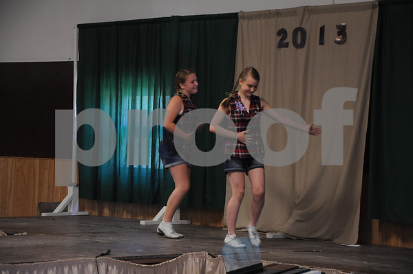 "-Messenger photo by Joe Sutter<br /> <br /> Erin Eldridge, 12, and Emma Stuhrenberg, 14, both of Callender, perform a clogging routine they choreographed themselves to ""Dueling Banjos."""