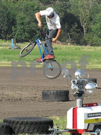 Spencer Sullivan performing a stunt in the BMX stunt show at the Webster County Fair.