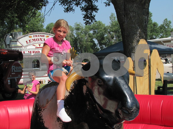 Maia Davis rode the mechanical bull at the Webster County Fair.
