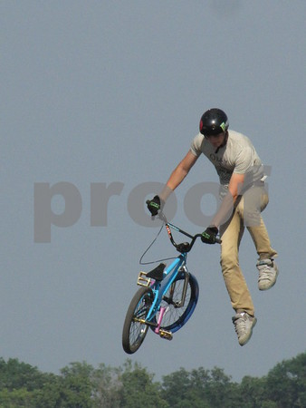 Skylar Wieber performs a stunt in the BMX stunt show at the Webster County Fair.