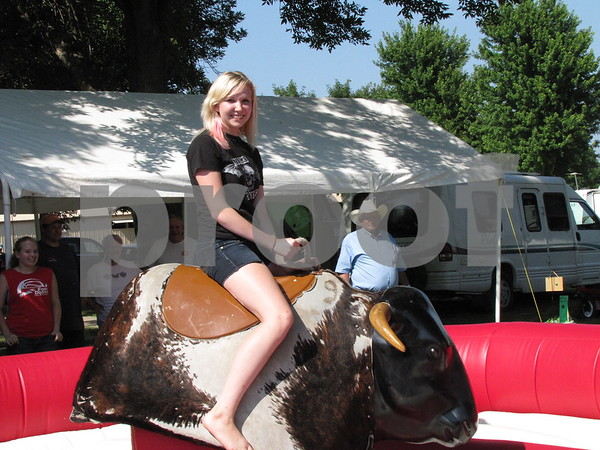 Miranda Keith rode the mechanical bull at the Webster County Fair.