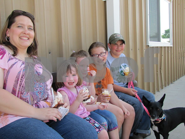 Jenny Marburger with her children Shaelynn, Ailey, Madilynn, and Ahren enjoy ice cream sundaes after the dog show at the fair.