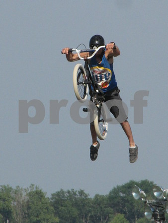 Justin Fenger performing a stunt in the BMX stunt show at the Webster County Fair.