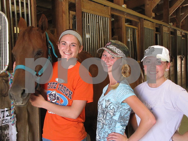 """Annie"" with Kourtney Condon, Mackenzie Nelson, and Katie Zabel at the Webster County Fair."