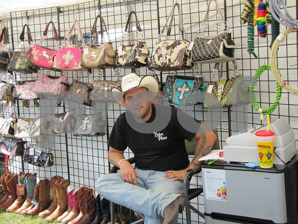 Sam Bender in his booth at the Webster County Fair.