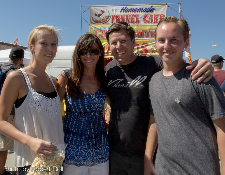 As high-speed aircraft whiz overhead, Richard and his family stop for a snack during Saturday's Wings Over Camarillo Air Show.  Wings Over Camarillo is presented by Camarillo Wings Association, which supports the nation's youth with aviation-related programs, educational scholarships, and endowments associated with higher education.
