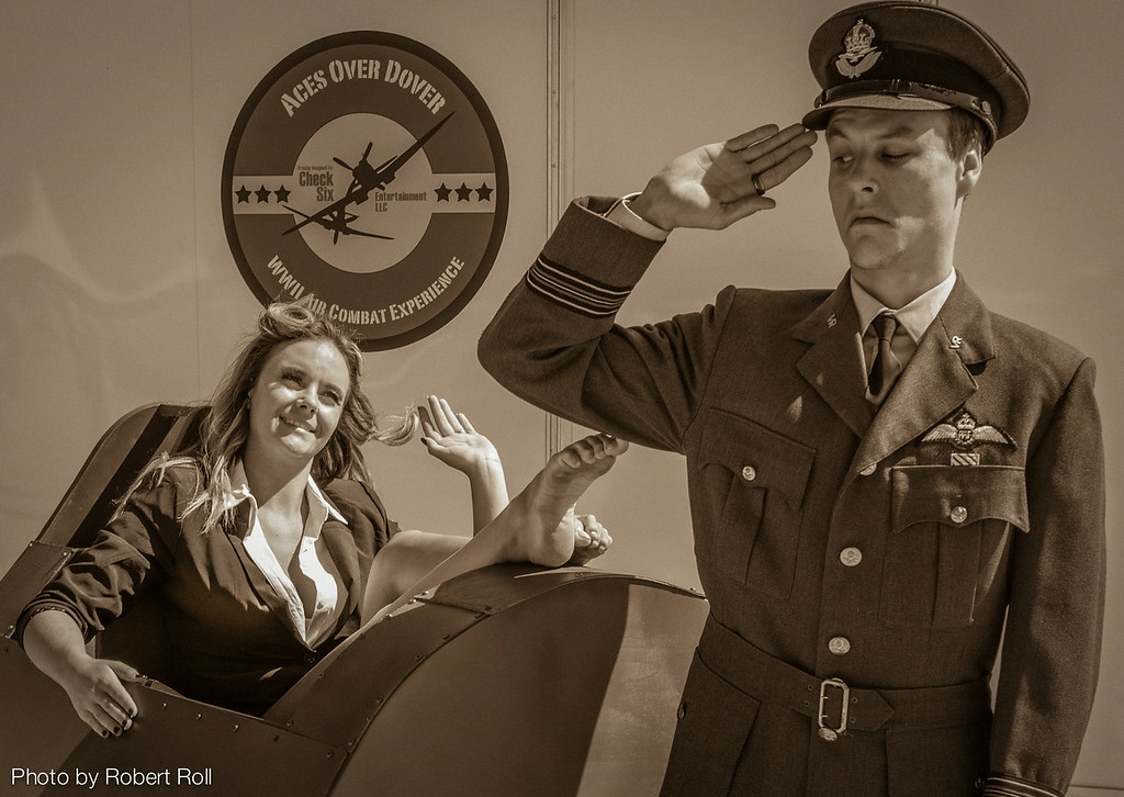 As a WWII RAF pilot, Christopher Miller of Thousand Oaks endeavors to maintain his stiff upper lip while Cara Milham does her best to loosen it.  It's all part of the fun at the 2014 Wings Over Camarillo Air Show.