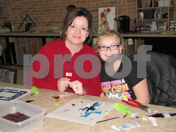 Lyn and Katelyn Adson spent some time in the warm, fun atmosphere at Studio Fusion creating a glass project to be fused.