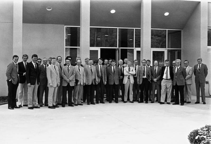 Community College Presidents - October 5, 1984<br /> Photo taken at Wilkes Community College<br /> 32 of the 58 presidents are in the photo<br /> Presidents' Quarterly Meeting<br /> <br /> Front row, L to R:<br /> David Daniel (Wilkes CC), Vincent Crisp (Tri-County CC), Jerry Owens (Rockingham CC), Kenneth Melvin (Richmond CC), Phil Taylor (Halifax CC), Swanson Richards (Surry CC), Parker Chesson (College of The Albemarle), Eric McKeithan (Caldwell CC & TI), Ron McCarter (Alamance CC), Bill Killian (Blue Ridge CC), Bennie Hampton (Montgomery CC), Mert Branson (Randolph CC), Bob Papp (Catawba Valley CC)<br /> <br /> Back row, L to R:<br /> Bryan Brooks (Davidson County CC), Jim Richardson (Western Piedmont CC), Clyde Erwin (Wayne CC), Dan Moore (Southeastern CC), Clif Paderick (Sampson CC), Don Bryant (Carteret CC), Ed Chapman (Anson CC), Leroy Henderson (Coastal Carolina CC), Carl Price (James Sprunt CC), Jim Petty (Cleveland CC), Travis Martin (Martin CC), Bob Greene (Forsyth TCC), Jim Blanton (Beaufort County CC), Charles Poindexter (Mitchell CC), Wayne Scott (Gaston College), Paul Johnson (Pamlico CC), Jesse McDaniel (Lenoir CC), Ed Cox (Piedmont CC), Fred Williams (Robeson CC)<br /> <br /> Scan of a photo provided to all the presidents by David Daniel in 1984.