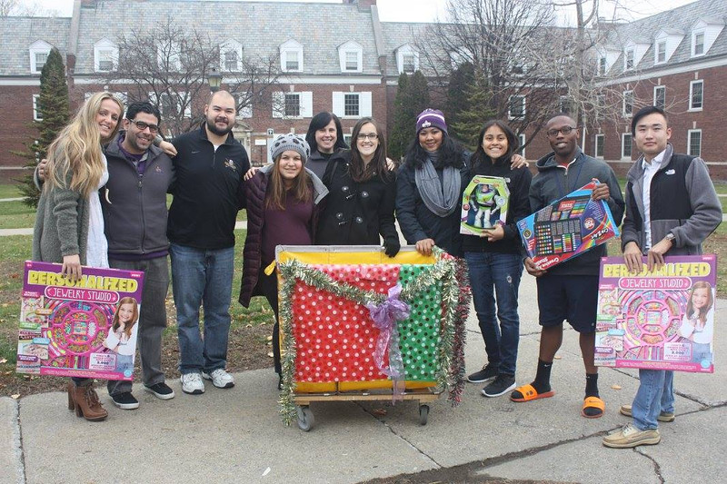 UAlbany students, faculty and staff deliver gifts to the Parsons Child and Family Center of Albany and Northeast Parent and Child Society of Schenectady.