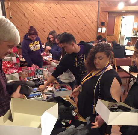 "Cornerstone Campus Ministry students pack ""Christmas-at-Sea"" boxes for sailors."