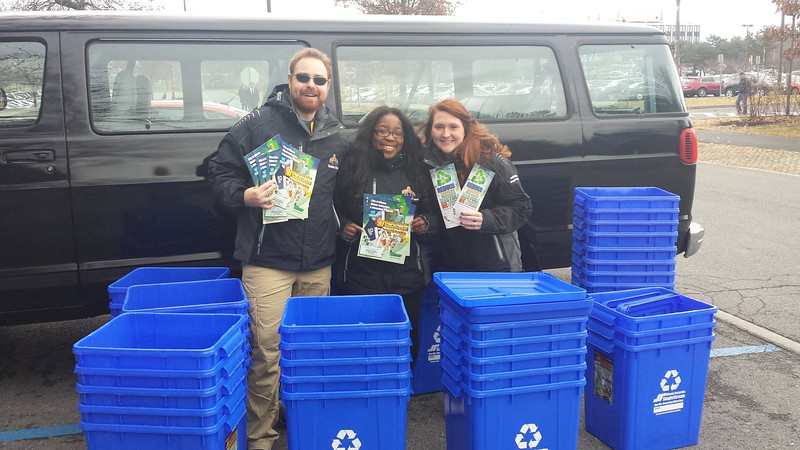 Off-Campus Ambassadors work with the City of Albany Department of General Services to deliver 100 recycling bins to Pine Hills residents.