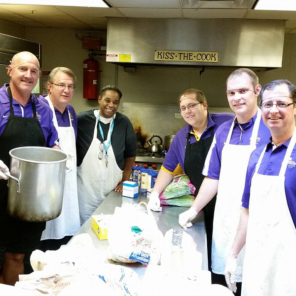Coaches and staff from UAlbany Athletics volunteer at the Interfaith Partnership for the Homeless.