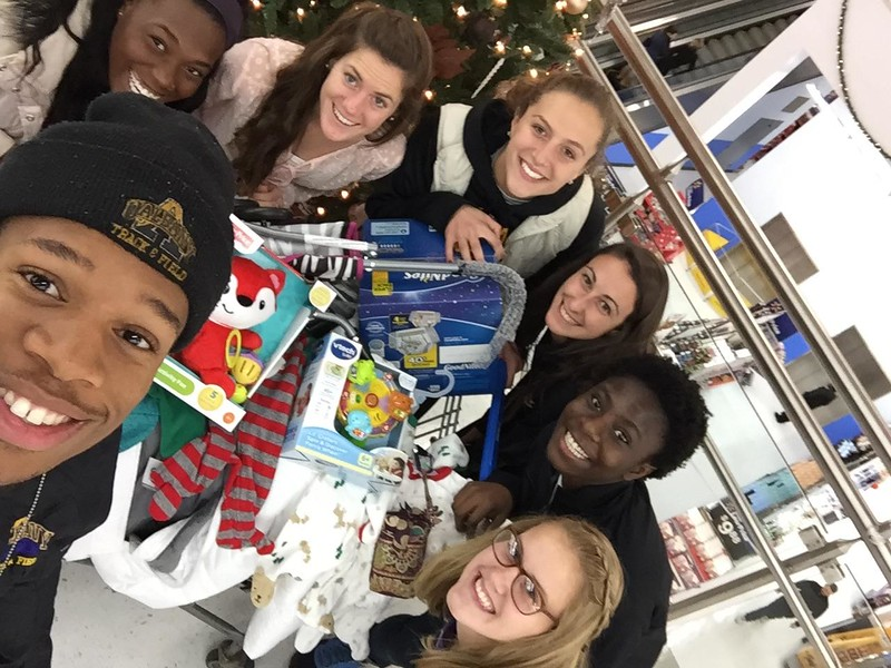 "Student athletes supporting Albany County's ""Adopt-a-Family"" initiative."