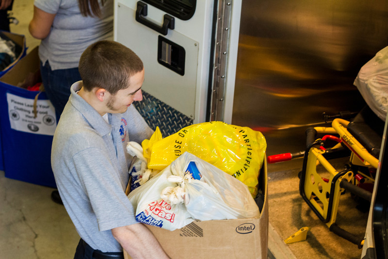 UAlbany's 5Quad Student-Run Ambulance Service gathers gifts for delivery to the Capital City Rescue Center.  Photographer: Bill Pyke