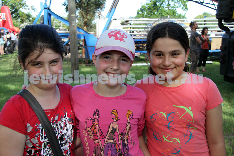 5-12-10. Chanukah in the Park. From left: Amy Gilbert, Aviva Jacobs, Angelina Atanaffova. Photo: Peter Haskin