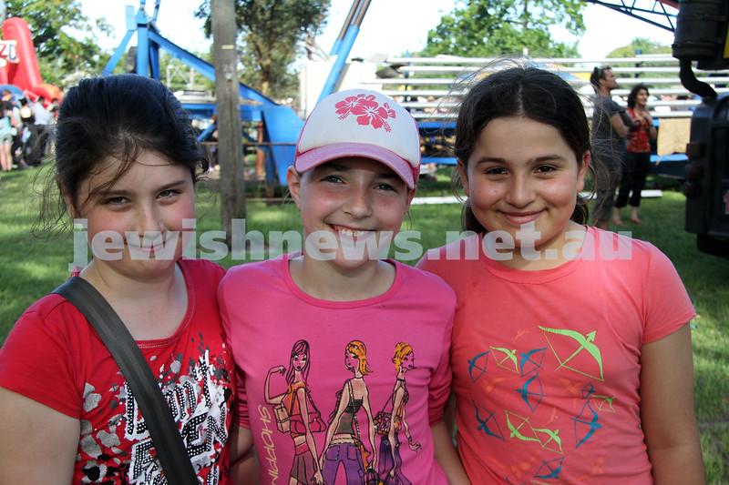 5-12-10. Chanukah in the Park. From left: Amy Gilbert, Aviva Jacobs, Angelina Atanaffova. Photo: Peter Haskin