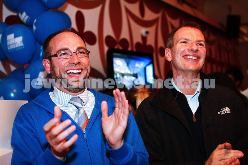 7-9-13. Election day 2013. Liberal candidate for Melbourne Ports, Kevin Ekendahl (left) with state member for Caulfield, David Southwick listening to Tony Abbott's acceptance speech. Photo: Peter Haskin